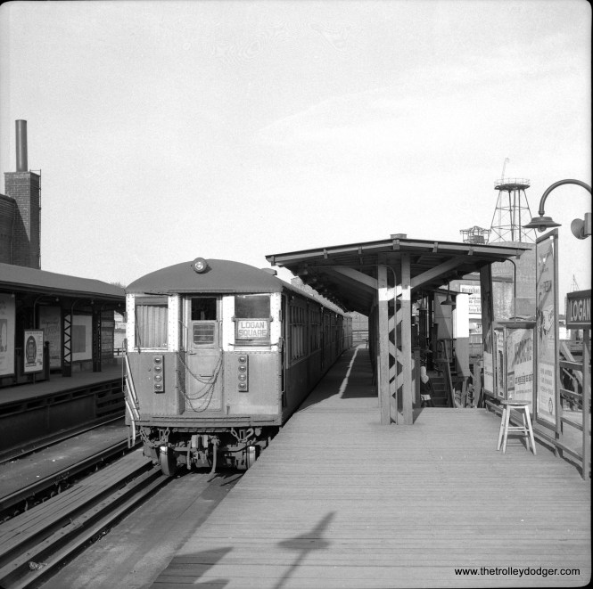 """A downtown-bound train at the old Logan Square """"L"""" station on May 10, 1958, about 6 weeks before service on the Milwaukee-Dearborn subway was connected up with the Congress and Douglas branches. (Laurence H. Boehuring Photo)"""