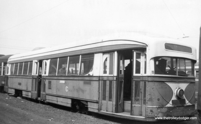 The experimental pre-PCC car 7001, built by Brill in 1934, spent its final years as a shed at 77th and Vincennes before being scrapped in 1959. It was briefly considered for purchase by the fledgling Illinois Electric Railway Museum, but was passed up because its windows were considered to be at the wrong height for its intended use as a hot dog stand. Ideas about historic preservation were different back then. (Railway Negative Exchange Photo)