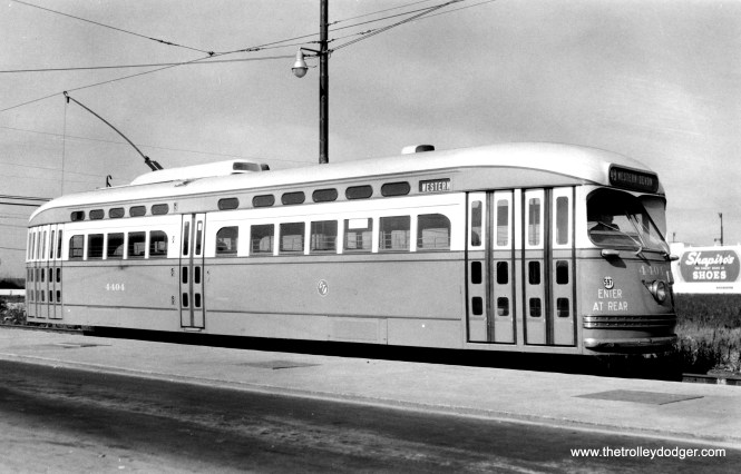"The curved lines of St. Louis-built PCC 4404 are evident in this view. The car is signed for Western and Devon on route 49, meaning we are heading northbound. Likely, this picture was taken prior to the opening of the CTA loop at Western and Berwyn on August 1, 1948. George Trapp adds that this photo was probably taken ""between Aug. 10th, 1948 when the car was delivered and Dec. 12th, 1948 when Berwyn became the official North terminal. Before Dec. 12th, 1948 the Schreiber Loop at the Devon Depot was the North terminal when PCC's were put on Western and the route was cut back from Howard on the North and 111th on the South."" (Joe L. Diaz Photo)"