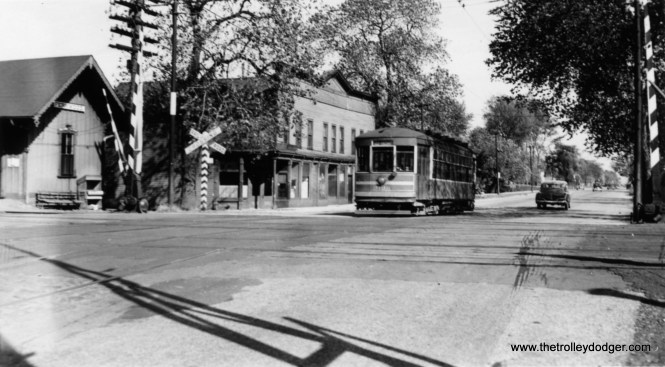 "The sign on the train station identifies it as Fernwood. That should help us determine the location of CSL 3100. Bill Shapotkin writes, ""This picture is on 103rd St (I believe looking east). The car is W/B and about to x/o the C&WI."""