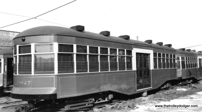 """CSL trailer 8027, built by the Surface Lines in 1921 during a time when ridership was greatly increasing. Trailers were no longer needed in the 1930s due to the Depression, and while they were considered for use during World War II they ended up as storage sheds such as this one. According to George Trapp, this photo was taken at the Devon Depot. Andre Kristopans: """"As for the trailers, all were sheds by 1930 or so. Some were fixed up to go back into service about 1942, but never did, and these were the ones scrapped in 1944-45."""""""