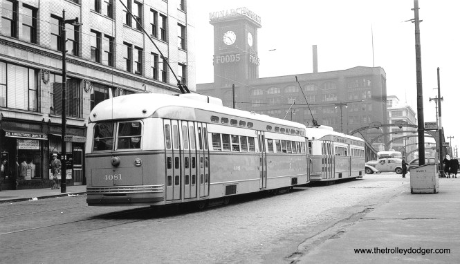 """CSL 4081 and another PCC are northbound on Clark at Wacker Drive, June 13, 1947. (J. William Vigrass Collection) On the back of the photo it says the second car is 7174, but George Trapp counters, """"The St. Louis built car cannot be 7174 based on the date, car 7174 being delivered 2/25/48. Note the car has a CSL logo and also has its rear marker and stop lights mounted on tubes, a spotting feature of the first 90 St. Louis Post War PCC's. It looks to me like the car is either 7071 or 7074."""""""