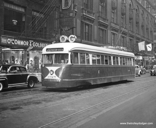 CSL 4028 is eastbound on Madison at Dearborn in Chicago's Loop, having already changed the sign for the trip west . O'Connor and Goldberg shoe stores were once a fixture throughout the Chicago area, with 15 locations. (Ohio Brass Company Photo)