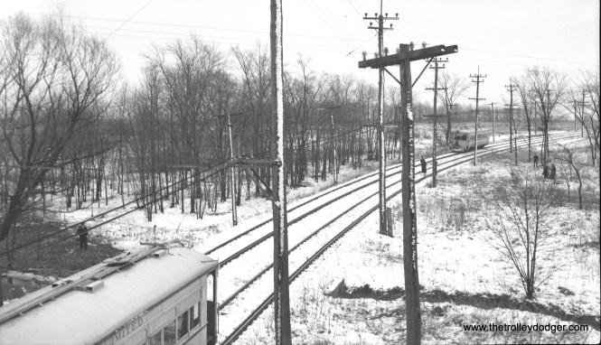 In a 1951 snow scene, LVT 702 meets a 1000-series car.
