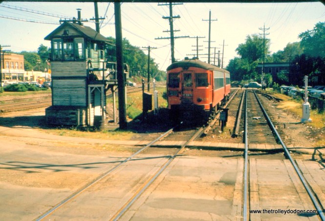 "This 1955 photo's a bit of a mystery. Could this be Wheaton? William Barber: ""Yes, this is Wheaton at the grade crossing immediately east of the depot."" Bill Shapotkin: ""This pic is Cross St, Wheaton. View looks east."""