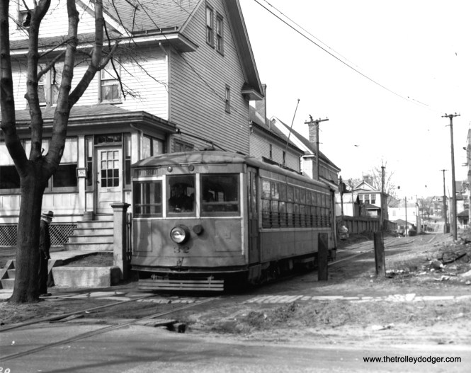 "New York and Queens Transit car 32 on the Jamiaca line private right-of-way at 89th. This is what the late author Stephen L. Meyers referred to as a ""backyard interurban,"" in his book Lost Trolleys of Queens and Long Island. We posted a tribute to Stephen L. Meyers here."