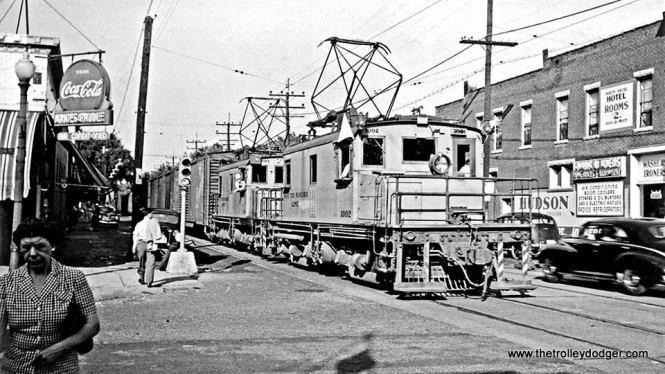 In this July1947 view, photographer Perry Frank Johnson captured Chicago South Shore & South Bend freight locomotive #1002 on busy Franklin Street in Michigan City, Indiana.
