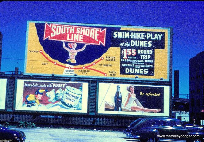 A sign advertising South Shore Line interurban service to the Indiana Dunes at Howard Street in Chicago, 1949.