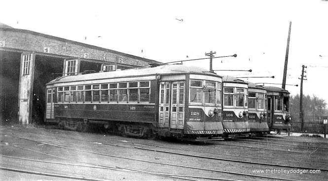 C&WT cars 128, 104,122, and 152 at the car barn at Harlem and Cermak in 1941.