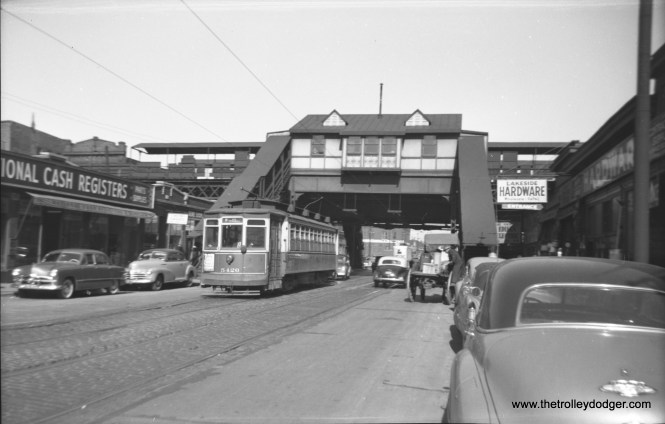 """CTA 5426 is on route 8 at Halsted and Lake, having just passed the """"L"""". The National Cash Register Company was located at 178 N. Halsted, just south of the """"L"""", so we are looking north."""