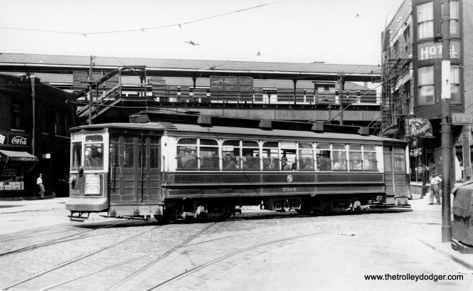 "CTA 5565 on September 10, 1949. This was known as a Brill-American-Kuhlman car. M. E. writes, ""Methinks this photo is at Root St. (4130 South) and Halsted. Under that assumption, the view faces north, the L is the Stock Yards L, and the streetcar is on the 44 Wallace-Racine line, heading from westbound on Root to southbound on Halsted."""
