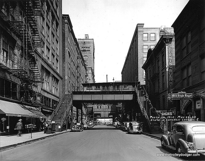 This 1939 view looks east on Congress from State St.. That's Sears at left. The 'L' station in the foreground is the Old Congress St. stub terminal, and the Congress & Wabash 'L' station is directly behind it. After the Congress stub was no longer needed for rush-hour rapid transit service, the North Shore Line continued to use it as a baggage terminal. (Eric Bronsky Collection)