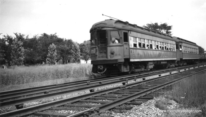 """A two-car CA&E train, headed up by 434, """"at speed."""" Not sure of the exact location. (H. L. Younger Photo)"""