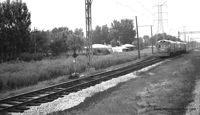An Electroliner at speed near Crawford looking west. This picture was taken from a passing train in 1960, three years before the North Shore Line quit. CTA's Skokie Swift began running in 1964. (Richard H. Young Photo)