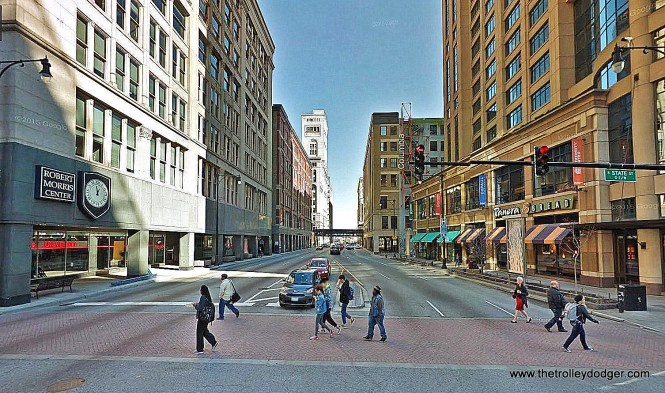 Here's the same view in November, 2015. During the 1950s, Congress St. was rebuilt into an artery feeding the Congress (now Eisenhower or I-290) Expressway. Street widening required cutting through Sears (and other buildings) to build arcaded sidewalks. The Congress & Wabash 'L' station was razed during the '50s and the stub terminal followed in 1964. CTA Green and Orange Line trains currently run on the 'L' visible in the distance. The building which once housed Sears is now Robert Morris Center. CERA meetings are currently held in University Center, the building at right.