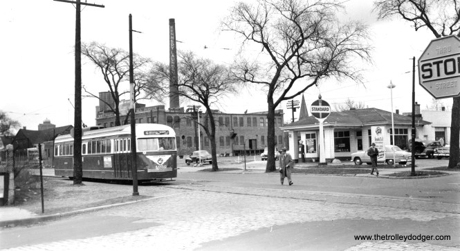 This photo was marked as being at Cottage Grove and 103rd, but it is actually at 113th. By blowing up the image, I was able to read the street signs. CTA prewar car 4050 is shown in May 1953, after having been converted to one-man.