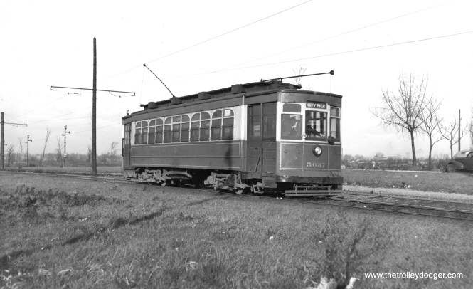 """CSL 5637 on Stony Island on December 1, 1946. Bob Lalich: """"CSL 5637 is a little north of 93rd St. The open space immediately east of Stony Island was a small quarry. CVS high school at 87th and Jeffery can be seen in the background to the right of the car."""""""