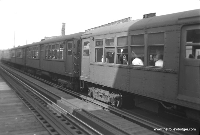 "A woman on CTA ""baldy"" car 4031 notices her picture is being taken at an unidentified location. As you can see, these 1913 ""L"" cars featured sideways seating."
