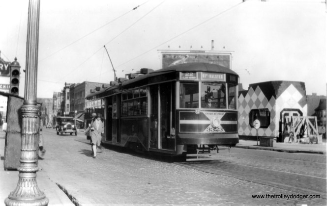 CSL Sedan 3323 is southbound on Clark at Sheffield. The rather odd building at right is still there. (Edward Frank, Jr. Photo)