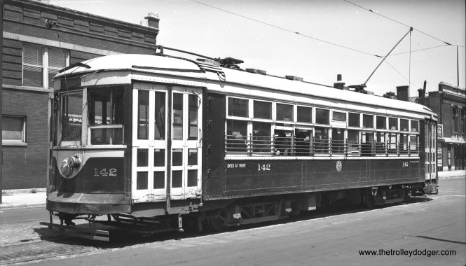 """Chicago & West Towns 142 at the east end of the Lake Street line at Austin Boulevard on July 4, 1946. The building at right is the old Park Theatre. This is a """"sister"""" car to the 141, now preserved in operating condition at the Illinois Railway Museum."""