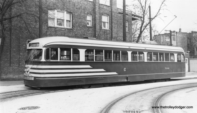 """CSL pre-war PCC 7002 is in the Madison-Austin loop, at the west end of busy route 20, circa 1945-46 in """"tiger stripes"""" livery."""