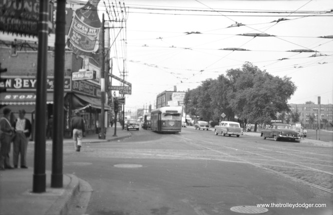 We are looking north on Clark and Devon in 1957, and a southbound route 22 - Clark-Wentworth car heads our way. It's difficult to make out the car number, but this may be 4390.