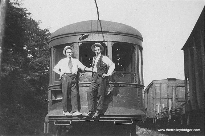 "Photo caption: ""Penn Central Railway #2 at Old Portage RR Cut, 1918. Motorman and Conductor on front."""