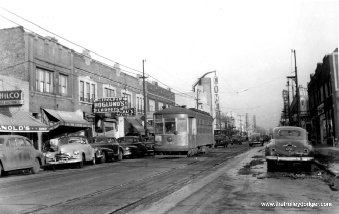 "CSL 3191 in the 1940s. The old Cine Theater, at rear, was located at 2516 W. Devon. According to Cinema Treasures, ""The Rapp & Rapp-designed Cine was opened in 1937 in the neighborhood of West Rogers Park, on Devon Avenue at Maplewood Avenue. The Cine closed in 1953 and was converted into a clothing store. The former theater has housed an Indian restaurant for many years."" (Edward Frank, Jr. Photo)"
