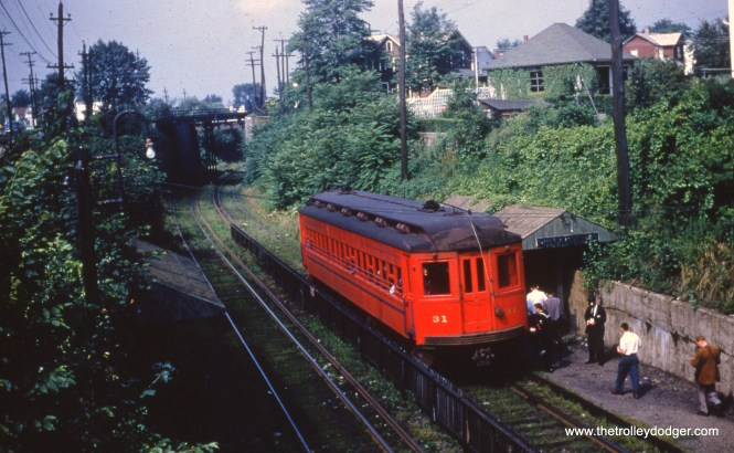 """Here is Lackawana & Wyoming Valley 31 as it appeared on August 3, 1952. Passenger service ended on this third-rail line at the end of that year. Some have wondered if the LL rolling stock could have benefited the Chicago, Aurora & Elgin, but the general consensus is these cars would have been too long to navigate the tight curves on the Loop """"L"""", although perhaps they could have been used west of Forest Park. As it was, there were no takers and all were scrapped. Ironically, some thought was later given by a museum of adapting a CA&E curved-side car into an ersatz Laurel Line replica, but this idea was dropped."""