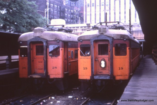 South Shore Line cars 28 and 19 at the Randolph Street station in downtown Chicago in March 1978. By then, these cars were more than 50 years old and had but a few more years to run. That's the Prudential Building in the background. Since then, this station has been rebuilt and is now underneath Millennium Park.