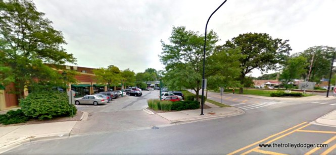 A current view of where the North Shore Line station in downtown Wilmette was once located. We are at the corner of Wilmette Avenue and Poplar Drive, looking to the southeast. The station was located in what is now the parking lot of a strip mall. The storefronts at rear are on Greenleaf Avenue, where the CNS&M Shore Line Route turned east for some slow street running before connecting up with the CRT/CTA at Linden Avenue.