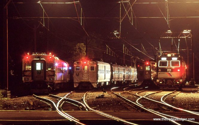 NJT yard line-up showing Comet coaches, Arrow MUs and a ALP-44 locomotive.