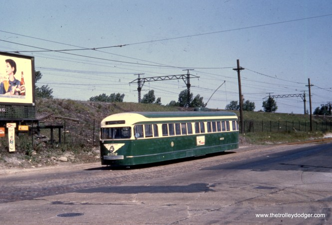 CTA one-man prewar PCC 4032 is shown southbound on route 4 - Cottage Grove in the early 1950s, where the line ran parallel to the Illinois Central's electric suburban commuter service.