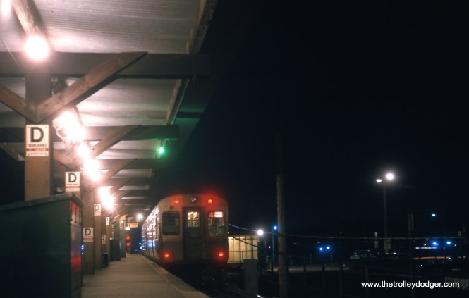 A two-car train of 6000s prepares to head east from the DesPlaines Avenue terminal on the CTA Congress branch in April 1964. This was the station arrangement from 1959 until the early 1980s. As I recall, the entrance at right in front of the train led to a narrow sidewalk where you had to cross the tracks in order to access the platform, hardly an ideal setup. At right there was a parking lot, and a few streaks of light show you where I-290 is located. The tracks today are in pretty much the same exact location, however.