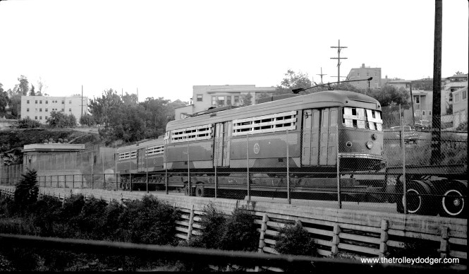 """Pacific Electric double-end PCC 502x is boarded up for a trip to Buenos Aires, Argentina. Don's Rail Photos says this car was """"built by Pullman-Standard in October 1940, #W6642. It was retired in 1956 and was sold as FGU M.1523 and made modifications in 1959. It was retired in short time."""" You can see some additional pictures of these cars as they appeared in 1959 after being damaged by dripping lime deposits in the damp PE Subway here."""