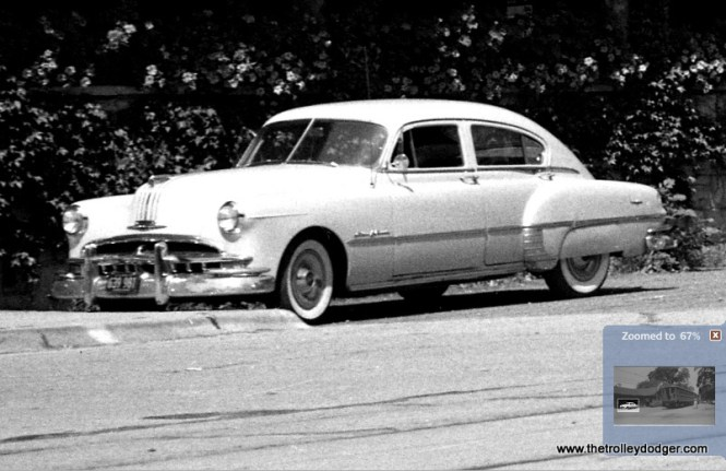 This looks like a 1952 Chevrolet 4-door Fleetline fastback to me, which would be a somewhat rare model with only a few thousand produced. The fastback, which had enjoyed a brief vogue starting around 1941, was dropped for the 1953 model year.