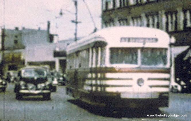 """A CTA prewar car in """"tiger stripes"""" on 63rd Street. (John Marton Collection) Andre Kristopans: """"The shot of the prewar car on 63rd in tiger stripes between shots of 4018 and 4010 is just east of 63rd and Indiana. For some reason, 63rd St is offset to the south about 50 feet from State to Indiana, this is why there appears to be a curve behind the car, as there really is a jog there."""""""