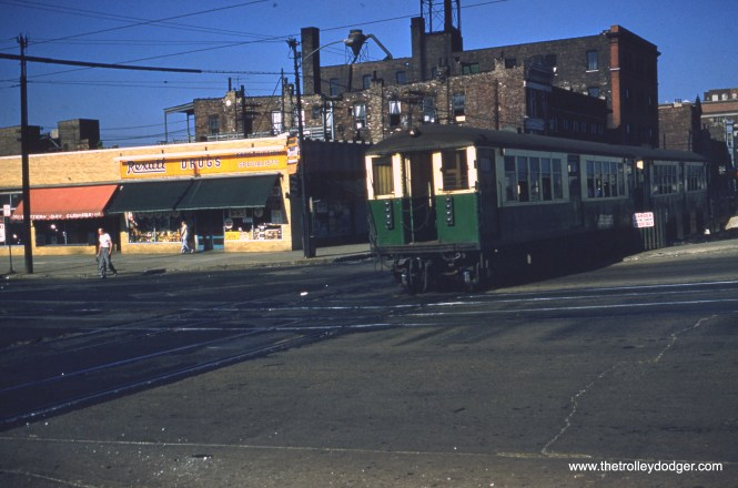 "A two-car train of CTA 4000s heads west on temporary trackage at Van Buren and Western on July 1, 1956. This was just two weeks after streetcar service ended on Western Avenue. This picture was taken around the time that the sounds of 4000-series ""L"" cars were recorded on the Garfield Park ""L"" for Railroad Record Club LP #36, which has been digitally remastered and is now available on compact disc in our Online Store."