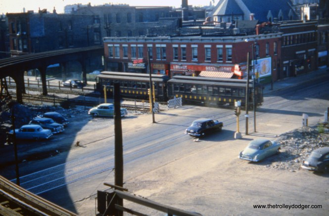 "It's 1953, and just prior to the opening of the temporary Van Buren trackage, we see a test train crossing Paulina. The streetcar tracks are for CTA route 9 - Ashland, which was still in service until early 1954. The photographer was standing on the platform at Marshfield Junction. The tracks veering off to the right, where Logan Square and Humboldt Park trains once ran, had been out of service since 1951. Garfield and Douglas trains were still running on the ""L"" when this picture was taken."