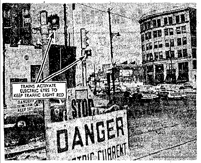 At intersections, the CTA used an innovative electric eye beam to make sure that stoplights did not change while trains were in the crossing. There were about 15 such cross streets along the 2.5 miles of this surface operation.