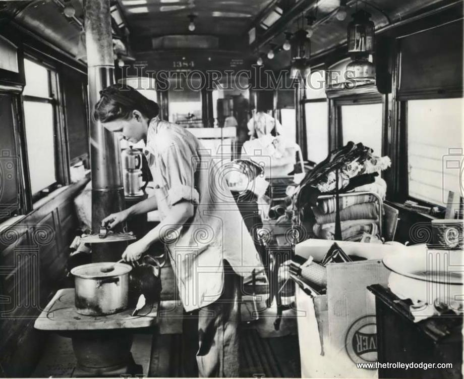 """To show you just how bad Chicago's postwar housing shortage was, some people purchased surplus streetcar bodies for use as temporary homes. The caption on this press photo reads, """"OVER-AGE STREET CAR BECOMES FAMILY'S HOME. CHICAGO- Mrs. Edith Sands prepares dinner on the small stove in the over-age streetcar where she and her husband, Arthur, and their five-month-old son, Jimmy, have just moved. The trolley car, which has seen nearly 50 years of service on Chicago streets, was purchased by the Sands at a recent public sale and propped up on a 5-acre site near Chicago's southern edge. The car is lighted by gasoline lamps."""" (April 16, 1946) In our post Lost and Found: Chicago Streetcar #1137 (June 5, 2015), we wrote about how one of these old streetcars, once used for housing, was recently discovered in Wisconsin. It has since been moved to a museum where it will hopefully be preserved."""