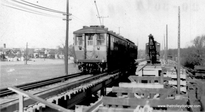 "Here, we have a difference of opinion. George Trapp: ""2 car train on single track is probably circa 1938-1943 as the 4000 series is in Brown/Orange. Believe location is Emerson St. and bridge is being installed where none existed before."" On the other hand, Brian M. Hicks says that this view ""is from Central St. looking North. The 2700 Hampton Pkwy apartments can be seen in the background (1930-31)."" (Allen T. Zagel Photo, George Trapp Collection)"