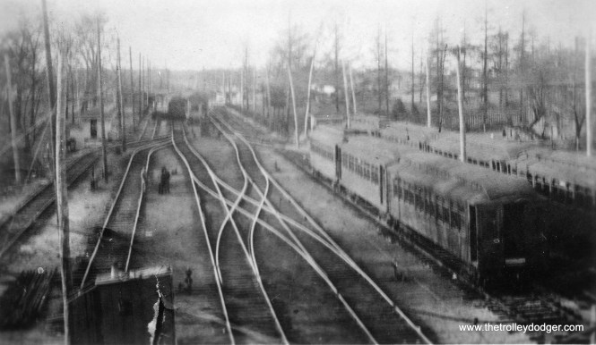 "The old Central Street yard in Evanston. According to www.chicago-l.org: ""The Central Street terminal consisted of a simple high-level wooden island platform and small headhouse at the north end of the platform near the street. The tracks and station were at ground-level, as was the entire Evanston extension of the Northwestern, as the ""L"" simply electrified the existing ground-level steam railroad's tracks. A small yard was built at Central Street, south of the station, for car storage, although its capacity was modest. Central Street also served as the main transfer point between the ""L"" and the Chicago & Milwaukee Electric interurban (ancestor of the North Shore Line). The C&ME had already been leasing the St. Paul's tracks for a few years from Linden Avenue in Wilmette to Church Street in downtown Evanston, where their terminal was located just a block from the ""L""'s Davis Street station. Transfer was also available to the Evanston Electric Railway Company's streetcar line, which ran along Central and then south on Sherman to downtown Evanston. (Later converted to motor buses, the line essentially became the Evanston Bus Company's Route #1, then the CTA's #201 Central-Sherman bus, now the #201 Central-Ridge.) By 1912, the Northwestern had outgrown its terminal at Central Street. There were also new riders to be had in the nearby suburb to the north, Wilmette. In February 1912, Northwestern President Britton I. Budd notified Wilmette officials of his extension intentions and, despite opposition that quickly developed, the line was extended on April 1, 1912. The Central Avenue yard was soon closed and the station's island platform was eventually replaced with a set of side platforms. A station house was located at the north end of the inbound platform."" (George Trapp Collection)"