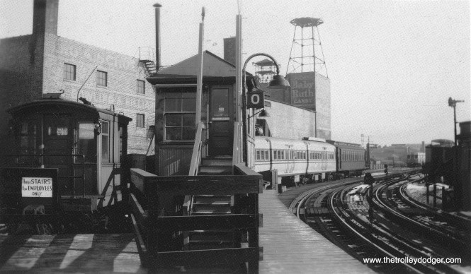 "One of the 5001-5004 ""doodlebugs"" and a Met car at Logan Square along with a work car. George Trapp: ""One of the Pullman built doodlebugs, 5001-5002 at Logan Square appears to be coupled to the Met's original steel dreadnought #2717. Odd for doodlebug to be at Logan Square at this time, 6000's in background with cream roofs date photo to 1950-51. Doodlebugs had been assigned to Evanston for over a year by this time."" Coupling modern equipment to 2717, and the timeframe, may provide an answer. Perhaps these cars were being used for testing in the Dearborn-Milwaukee subway, which opened in February 1951. Wood cars were banned from the subway by city ordinance, due to fire safety concerns, but this did not apply to 2717, as it was an early experiment with an all-steel car. (Edward Frank, Jr. Photo, George Trapp Collection)"