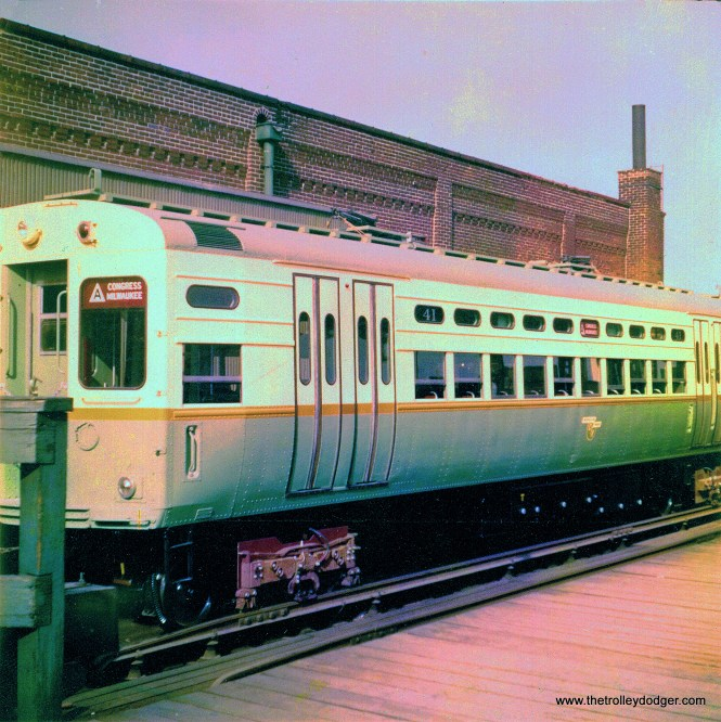 We have restored these four badly faded color prints as best we could. This one shows CTA single car unit 41 in 1959, as new, at Logan Square. Note it has not yet been fitted with trolley poles, which this car used when put into service in Evanston in 1961. (Robert Geis Photo, George Trapp Collection)
