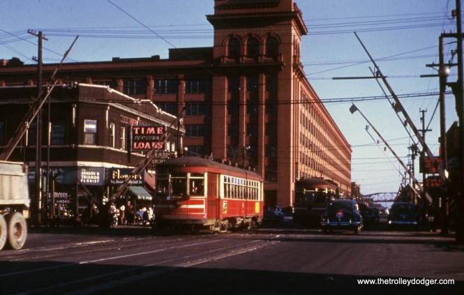 "CTA 3277 heads north on Cicero Avenue near Cermak in October 1951, crossing the Douglas Park ""L""."