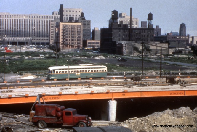 CTA PCC 7058 crossing the Congress Expressway construction site on Halsted in May 1952.