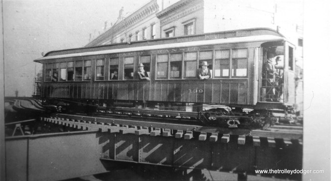 "South Side Rapid Transit car 139 rounding the curve at Harrison and State, probably in the late 1890s. George Foelschow: ""The photo of South Side car 139 on the Harrison curve April 16, 1898 appears on page 35 of CERA B-131, authored by Bruce Moffat. Multiple-unit inventor Frank Sprague may be at the controls, since he is pictured on the following page the next day on an M-U test at 61st Street yard. These tests presaged the steam to electric conversion on the South Side ""L""."" (George Trapp Collection)"