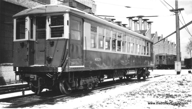 "CRT 4320 at Skokie Shops, freshly repainted. George Trapp: ""CRT 4320 not CTA, car is freshly painted in CRT Green and Orange and is a Met assigned car note position of safety springs and Van Dorn coupler."" Comparison with a similar photograph dates this one to 1937. (Allen T. Zagel Photo, George Trapp Collection)"