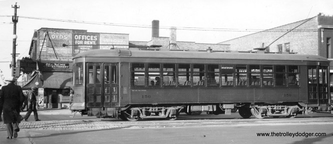 """Chicago and West Towns car 156 on 22nd Street (or was it already called Cermak road) in Cicero, 1936. The car is heading west and we can just see a glimpse of the Douglas Park """"L"""", which runs just north of Cermak. The car is signed to go to Riverside. Don's Rail Photos: """"156 was built by Cummings Car Co in 1927. It was rebuilt in 1942 and scrapped in 1948."""""""